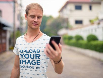 Sublimated T-Shirt Mockup Featuring a Man Looking at His Phone 40333-r-el2