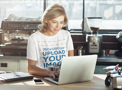 T-Shirt Mockup of a Middle-Aged Woman Working on Her Laptop 35081-r-el2