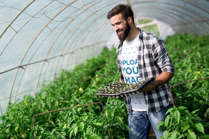 T-Shirt Mockup Featuring a Man in a Greenhouse 40662-r-el2