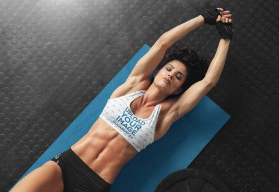 Sports Bra Mockup Featuring a Woman Stretching Over a Yoga Mat 34982-r-el2