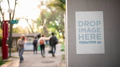 Video Mockup Of A Flyer Glued On A Concrete Wall While People Are Passing By a13980