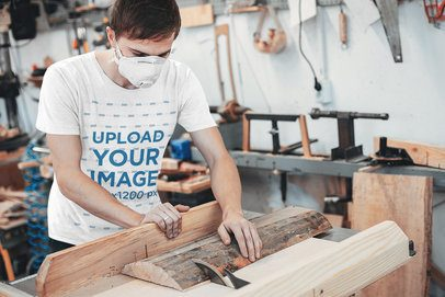 T-Shirt Mockup Featuring a Man Cutting Wood 38033-r-el2