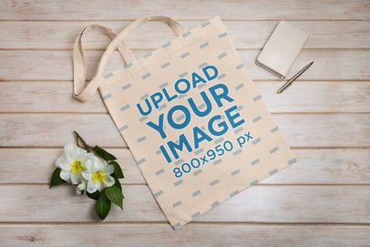 Mockup of a Flat Laid Customizable Tote Bag 41537-r-el2