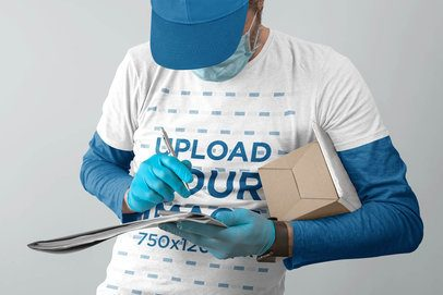 T-Shirt Mockup of a Courier Man with a Package 40135-r-el2
