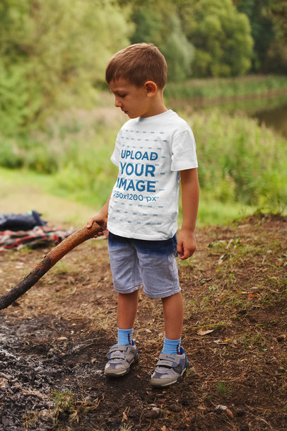 Mockup of a Kid Wearing a T-Shirt in the Forest 42088-r-el2