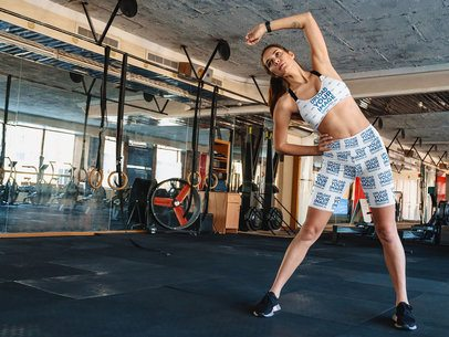 Sports Bra and Bike Shorts Mockup Featuring a Woman Exercising 41466-r-el2