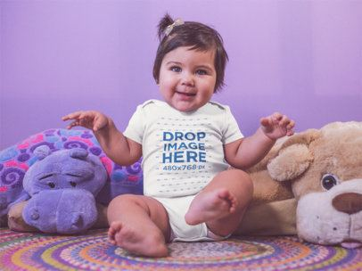 Little Baby Girl Dancing And Wearing A Onesie While Sitting Down On Her Carpet With Teddies Mockup a14046