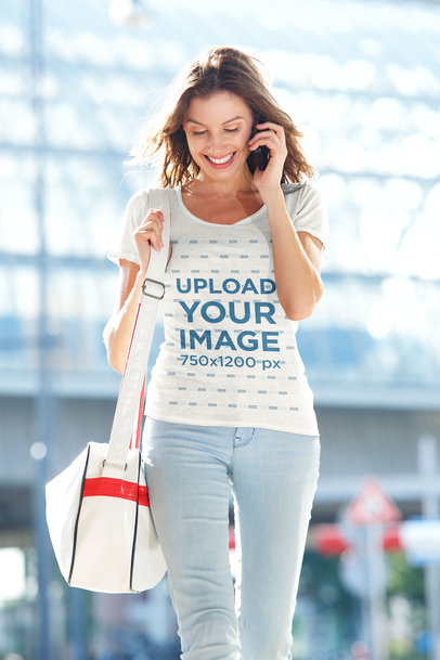 Heathered T-Shirt Mockup of a Happy Woman Talking on the Phone 39704-rel2