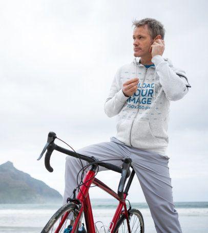 Hoodie Mockup of a Man Riding His Bike by the Beach 40471-r-el2