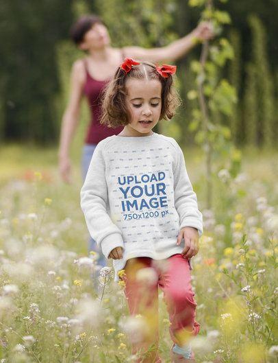 Crewneck Sweatshirt Mockup Featuring a Girl Walking Through a Field of Flowers 34784-r-el2