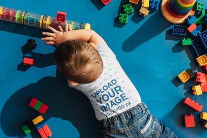 Top Shot Mockup of a Toddler with a T-Shirt Playing in His Room 41899-r-el2