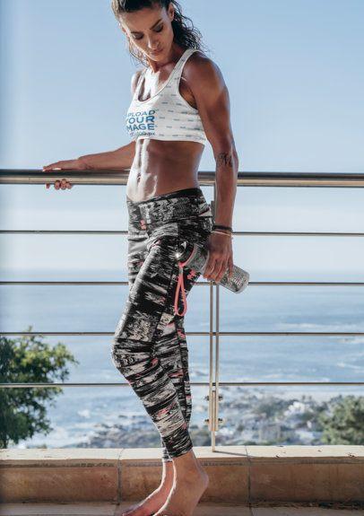 Sports Bra Mockup Featuring a Woman on a Beach-View Balcony 35669-r-el2