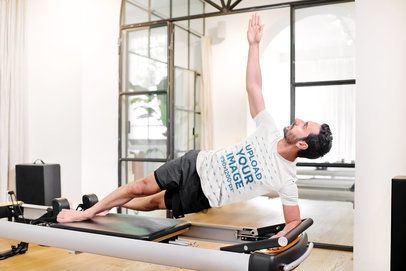 T-Shirt Mockup of a Man Doing a Side Plank on a Machine 38673-r-el2