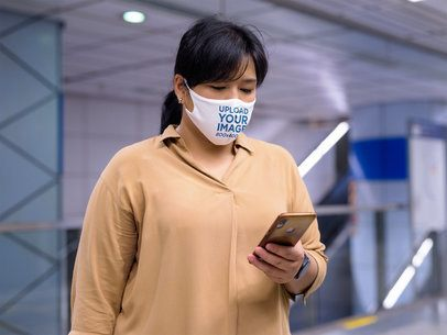 Face Mask Mockup Featuring a Woman Looking at Her Phone 41633-r-el2