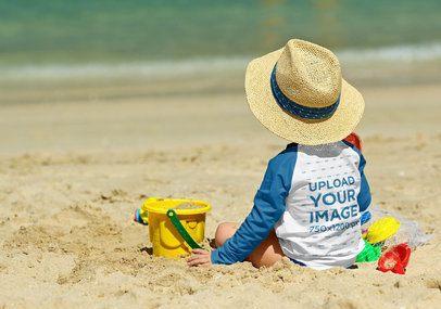 Back View Mockup of a Kid Wearing a Raglan Long-Sleeve Tee on the Beach 42111-r-el2