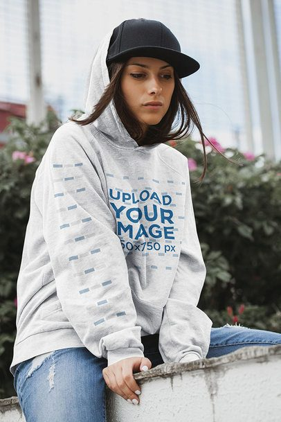 Mockup of a Woman Wearing an Oversize Heathered Hoodie Outside 40944-r-el2