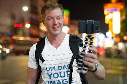V-Neck T-Shirt Mockup of a Man Visiting a City 41164-r-el2
