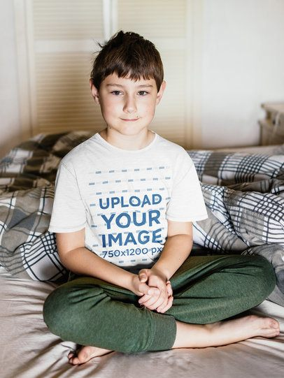 T-Shirt Mockup of a Boy Sitting on a Bed 39334-r-el2