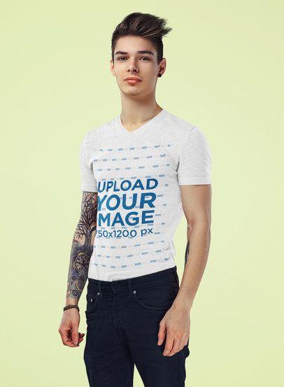 Mockup of a Tattooed Young Man Wearing a V-Neck T-Shirt at a Studio 38223-r-el2