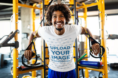 T-Shirt Mockup of a Man Exercising with Suspension Straps 40693-r-el2