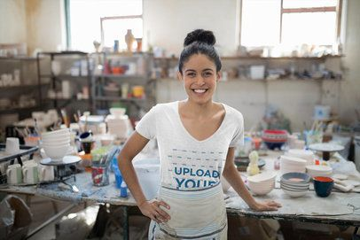 T-Shirt Mockup of a Smiling Woman at a Pottery 41582-r-el2