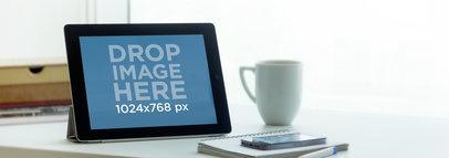 iPad Black Landscape On Desk Next To Window Wide