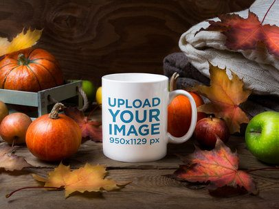 Mockup of an 11 oz Coffee Mug Surrounded by Fall Decorations 40995-r-el2