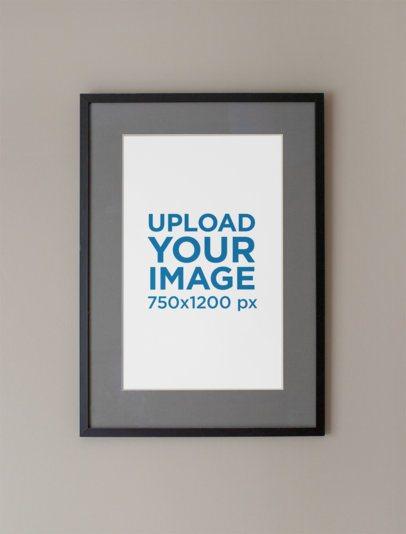 Mockup of a Framed Art Print Hanged on a Grey Wall 36294-r-el2