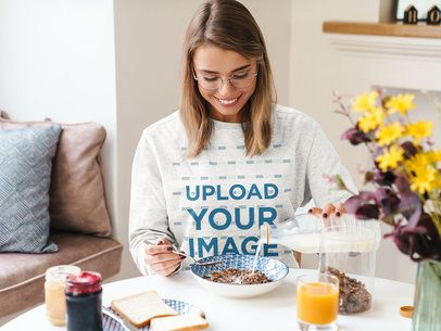 Mockup of a Woman with a Heathered Sweatshirt Having Cereal for Breakfast 40248-r-el2