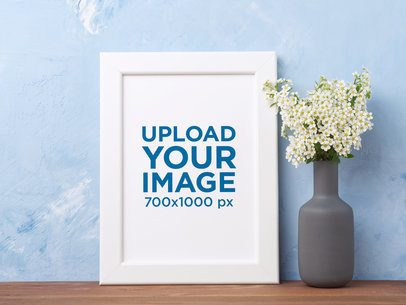 Mockup of an Art Print Next to a Vase Filled with Flowers 36007-r-el2