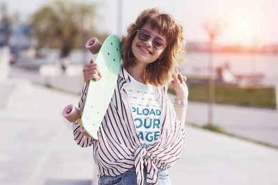 T-Shirt Mockup of a Happy Woman Carrying a Board in Her Hand 42227-r-el2