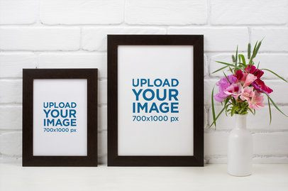 Mockup of Two Art Prints Next to a Flower Vase 37138-r-el2