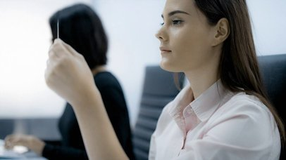 Beautiful Office Girl Looking at a Business Card While at Work Mockup Video 030817a