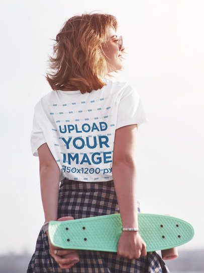 Back-View T-Shirt Mockup of a Woman Holding a Penny Skateboard 42231-r-el2