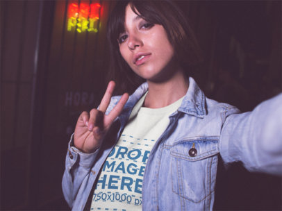 Selfie Mockup of a Hispanic Girl Wearing a Round Neck Tshirt While Outside a Closed Japanse Food Restaurant a13566
