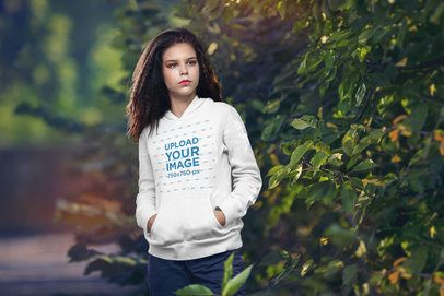 Pullover Hoodie Mockup Featuring a Young Woman Standing by Some Plants 4981-el1