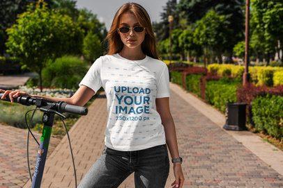 T-Shirt Mockup of a Woman Using a Scooter 4970-el1
