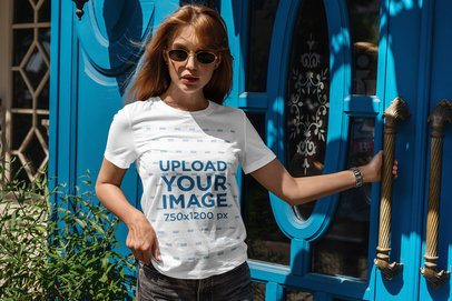 T-Shirt Mockup of a Woman Posing Outside a House with a Blue Door 4976-el1