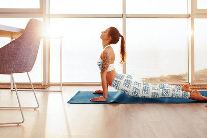Sports Bra Mockup of a Woman Wearing Sublimated Leggings While Doing Yoga by a Window 35268-r-el2