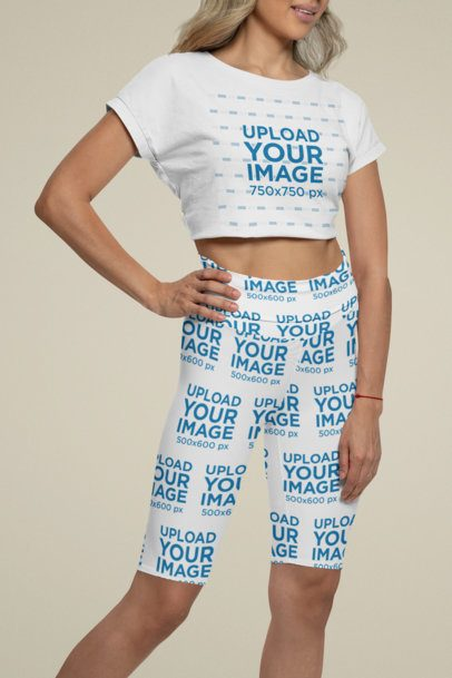 Mockup of a Woman Wearing a Crop Top and Bike Shorts in a Studio 42347