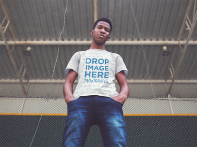 Young Black Guy Looking down While Wearing a Tshirt Mockup a14257