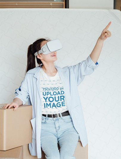 T-Shirt Mockup Featuring a Young Woman Wearing a VR Headset Device at Home 42615-r-el2