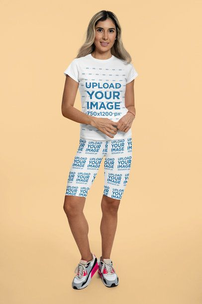 Mockup of a Woman Posing with a T-Shirt and Bike Shorts in a Studio 42315