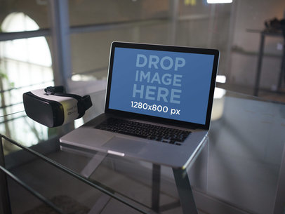 Template of a MacBook Pro and a Oculus Gear VR Device Lying on a Glass Desk a14245