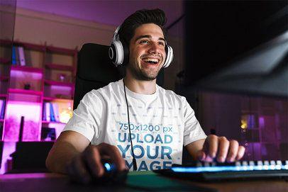 Mockup of a Gamer Wearing a Basic T-Shirt at Home 42612-r-el2
