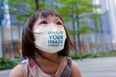 Face Mask Mockup of a Little Girl Enjoying the View in the City 41624-r-el2