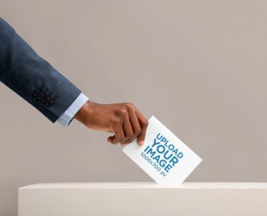 Mockup of a Man Placing a Folded Flyer Inside a Ballot Box 42249-r-el2