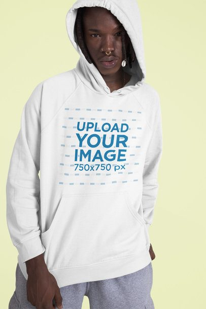 Mockup of a Serious Man Wearing a Customizable Pullover Hoodie 42985