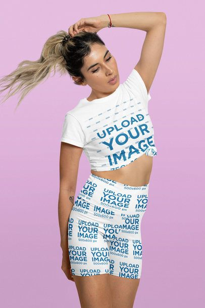 T-Shirt and Shorts Mockup of a Woman Flipping Her Ponytail 42314