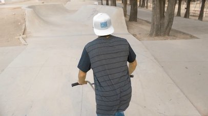 Young Guy Riding a BMX Bike While Wearing a Snapback Hat Backward in a Skatepark Video Mockup a14191